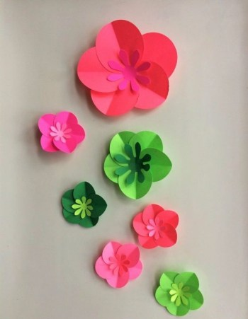Cute paper flowers on the wall