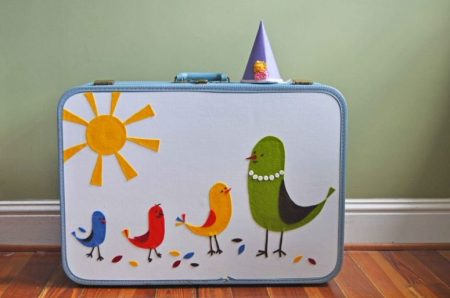 Makeover suitcase with bold appliques