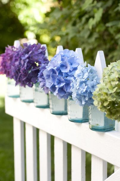 Fence-lined mason jars