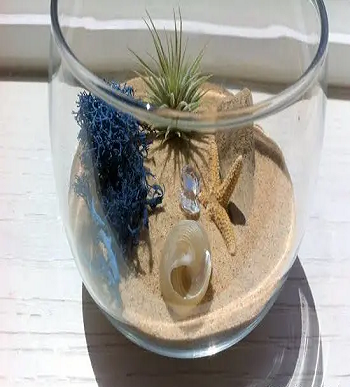 Miniature beach using stemless wine-glass DIY Tabletop Centerpiece Of Succulent In Wine Glasses