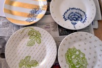 Plates with stenciled leaves