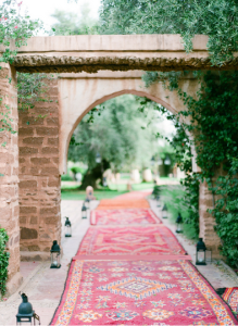 The best way to learn how to pray. Red carpet with forest background and an archway.