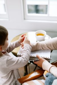 15 Powerful verses to pray over your children (Printable). The bible provides us with many powerful verses to pray. Child sitting at table with parent.