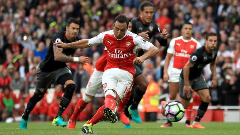 Arsenal's Santi Cazorla scores his side's second goal of the game from the penalty spot during the Premier League match at The Emirates Stadium, London.. Picture date: Saturday September 10, 2016. See PA story SOCCER Arsenal. Photo credit should read: John Walton/PA Wire. RESTRICTIONS: Editorial use only. Maximum 45 images during a match. No video emulation or promotion as 'live'. No use in games, competitions, merchandise, betting or single club/player services. No use with unofficial audio, video, data, fixtures or club/league logos.