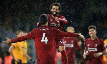 Virgil assiste Salah, Salah assiste Virgil. C'est beau. (Photo : Simon Stacpoole/Offside/Getty Images)