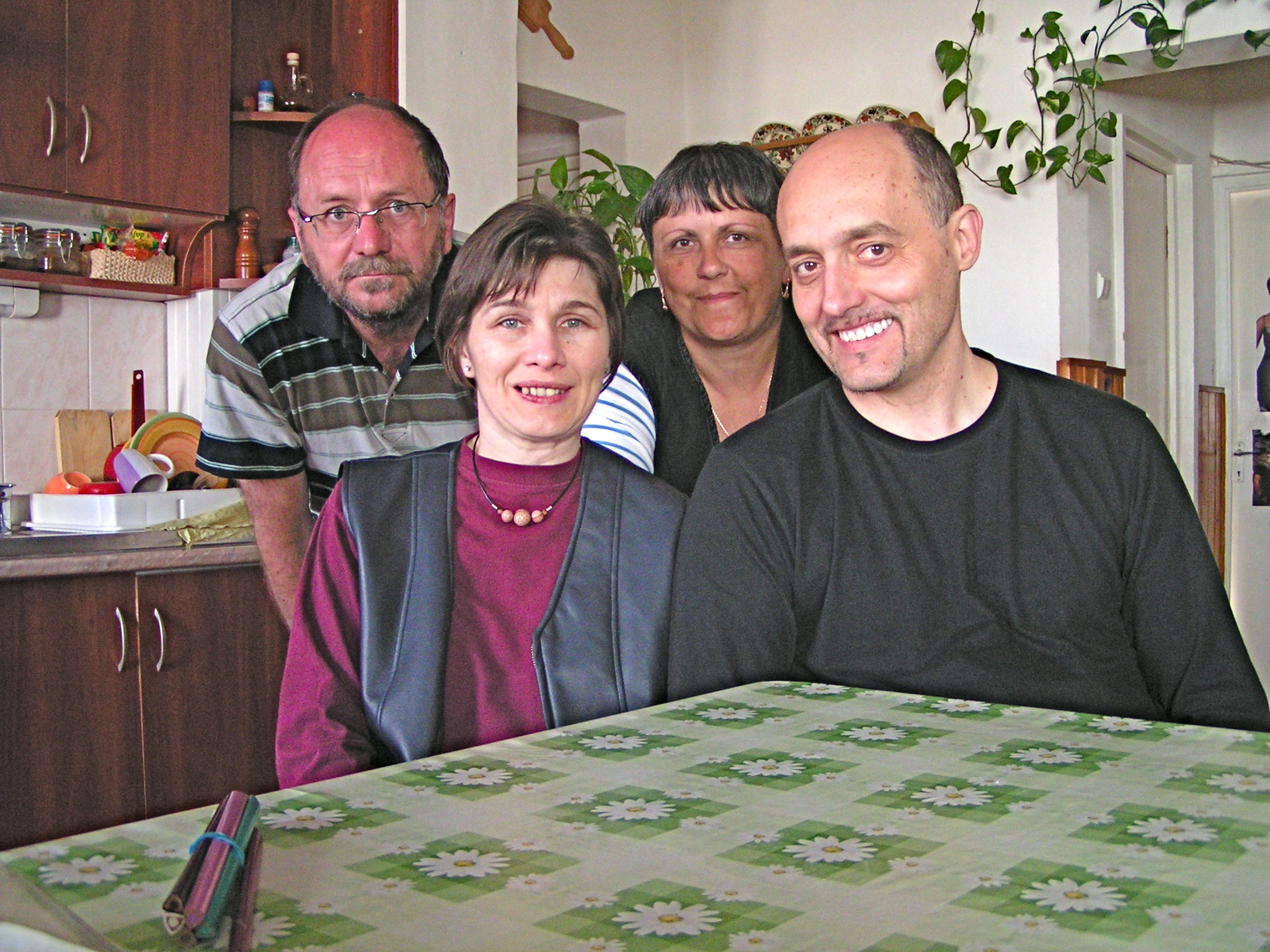 Jutka and Tibor (front left to right) read with Rosemarie.  Csilla, in the center of 2nd row, hopes to begin reading again soon.