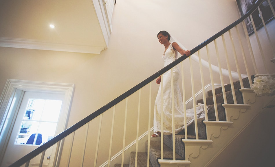 Jessica Elizse's lovely image of the bride and her train descending the main staircase at Godwick Hall