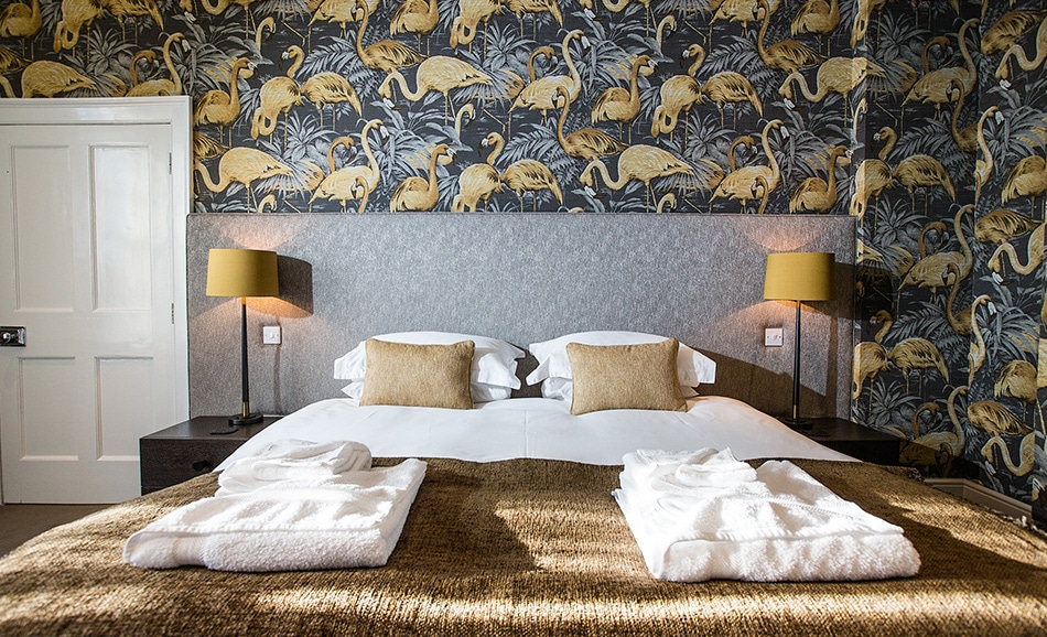 Jeremy Peter's landscape image of the Johnson suite, Godwick's latest room with funky flamingos