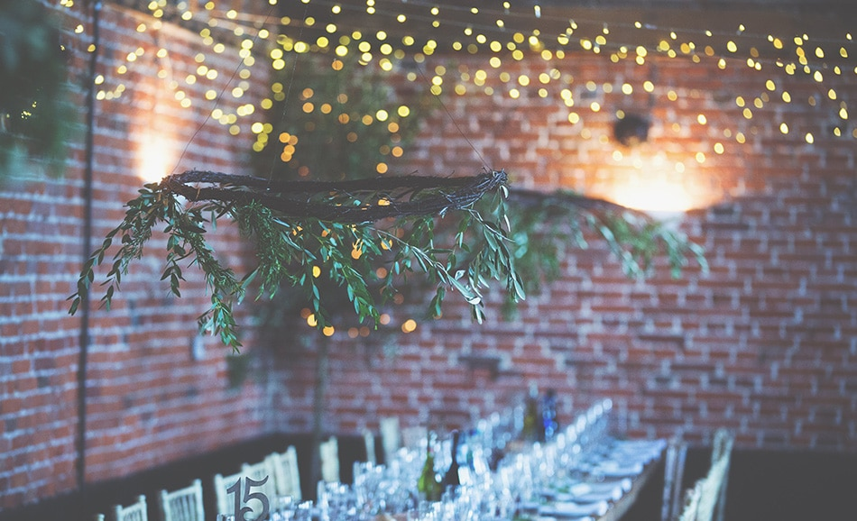 Jessica Elizse's image of wonderful hanging floral wreaths and Godwick trestle tables