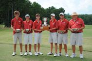 Golf team with trophy.