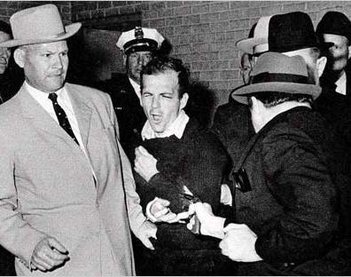 Lee Harvey Oswald being shot by Jack Ruby.