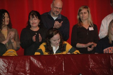 Bailey Hall signing her letter of intent to swim at William and Mary