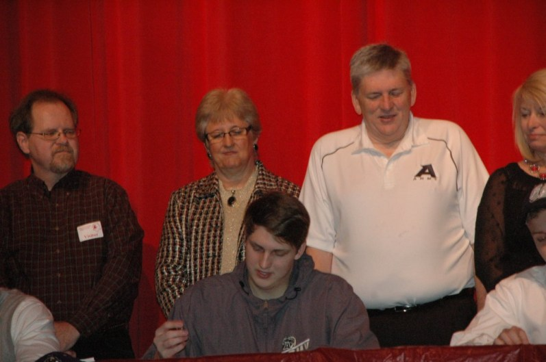 Jacob Kessler signing his letter of intent to play basketball at the United State Military Academy