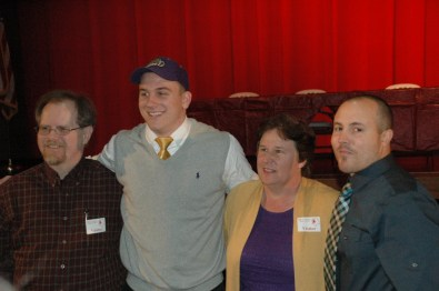 A.B. Rhodes with his parents and Godwin football coach John Phillips (r)