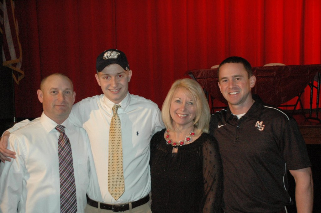 Patrick Hagerman with his parents and Godwin soccer coach Skip Stevens (r)