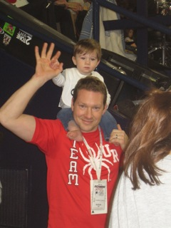 Cope's husband, Jason carrying their winning baby.