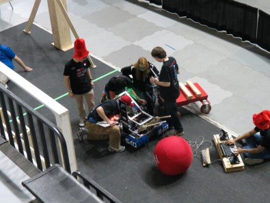 Members of the Robotics team working on the robot