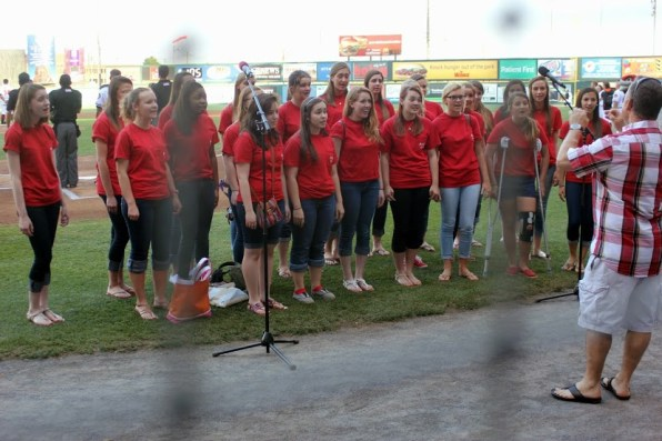 Singing in front of the crowd at the Flying Squirrels game