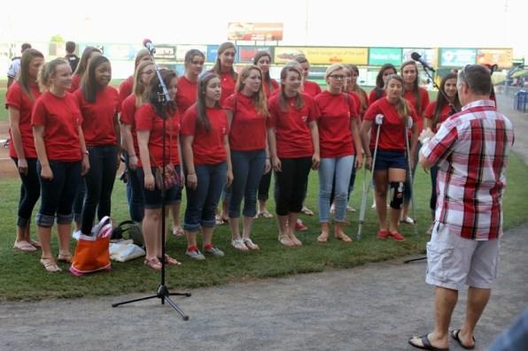 Chorus girls singing the National Anthem