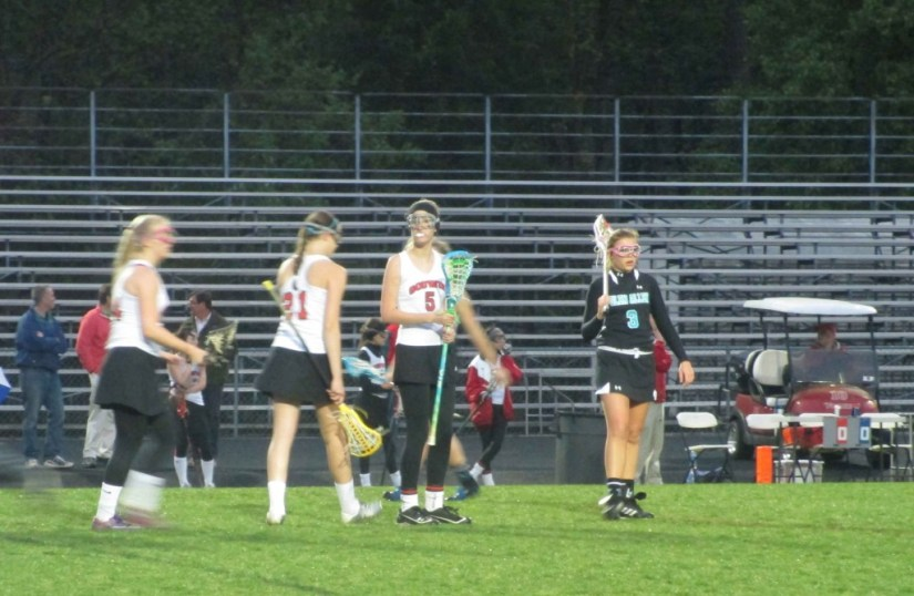 Girls lacrosse waiting to make the next play
