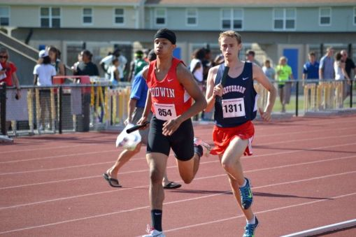 Godwin boys' track running the 4x800 meter relay