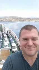Math teacher John Mustachio on a ferry crossing the Strait of Messina.