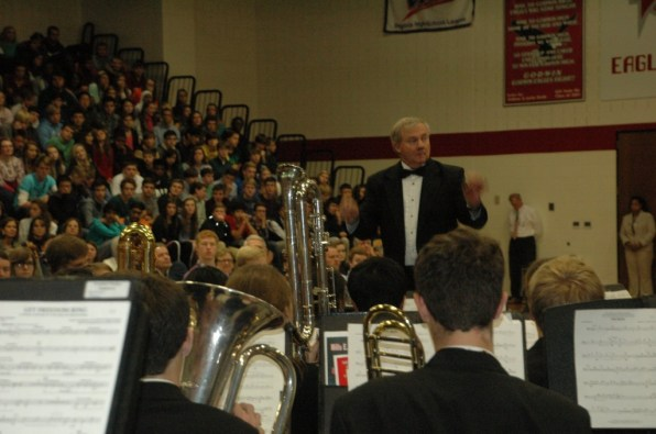 Mr. Auman directing the band during the Veteran's day assembly