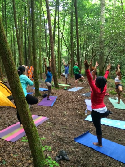 Yogis doing yoga at camp in the wild