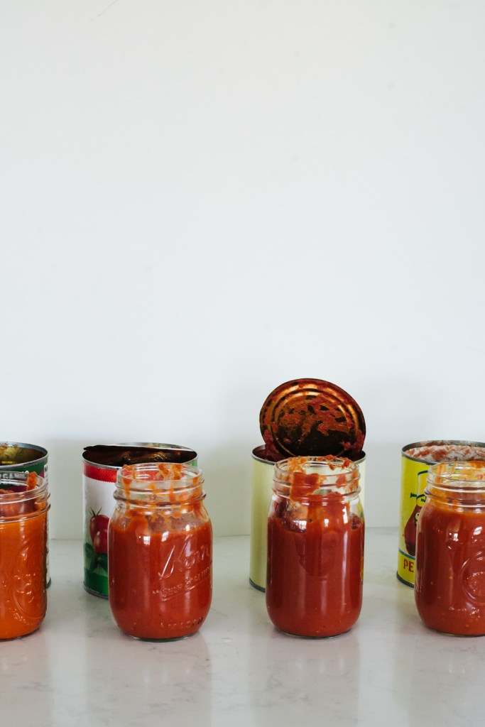 A comparison of four cans of tomatoes in a homemade tomato sauce recipe / Go Eat Your Bread with Joy