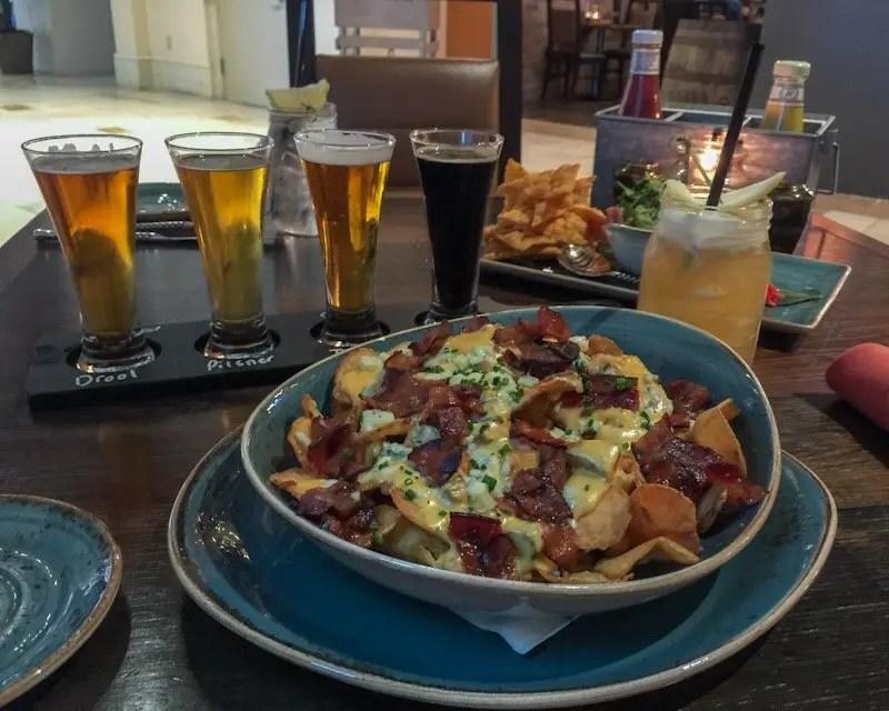 9 Reasons Foodies Love Rosen Shingle Creek Resort in Orlando Tobias loaded chips and beer fligfht