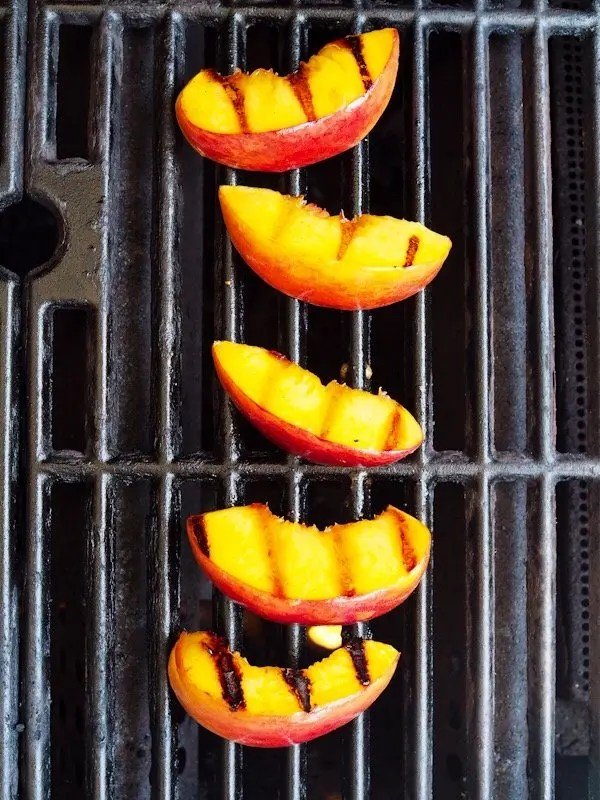 Learn tips on how to grill peaches with this recipe for Grilled Peaches & Wine Poached Cherries Mascarpone Whipped Cream Stack with CK Mondavi & Family Wines