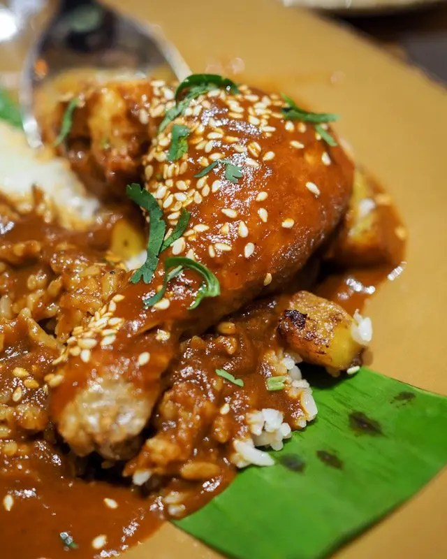 Oaxacan Chicken with Red Mole from Frontera Cocina at Disney Springs Taste of Oaxaca Seasonal Menu and Fun Random Facts about Mole including How To Make an Easy Mole from Chef Rick Bayless