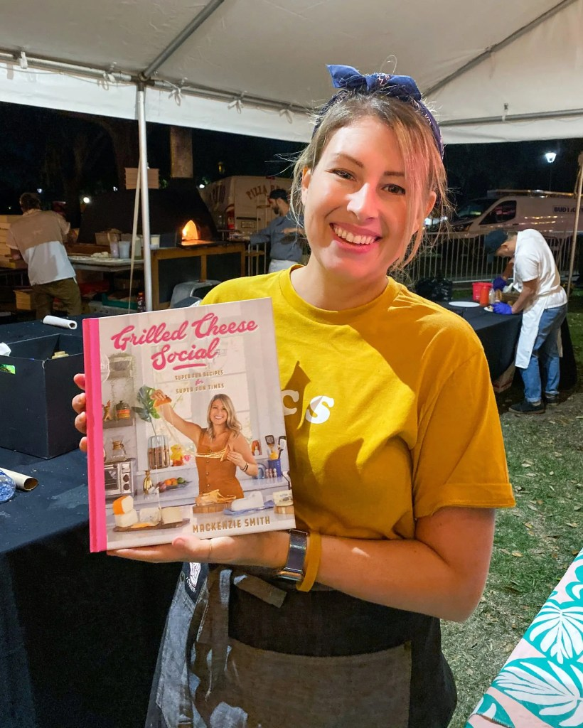 MacKenzie Smith of Grilled Cheese Social at Cows n Cabs in Orlando shows her new cookbook