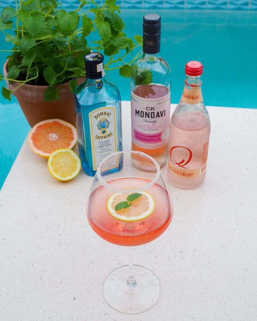 Easy Rose Moscato Citrus Spritzer cocktail to celebrate any occasion. Perfect warm weather sipper to chill and relax at home made with only 3 ingredients: Bombay Sapphire gin, CK Mondavi rose moscato wine and Q Mixers grapefruit soda. Cheers!