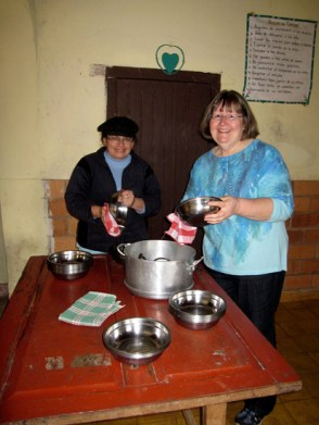 Mom working at the soup kitchen with Alba