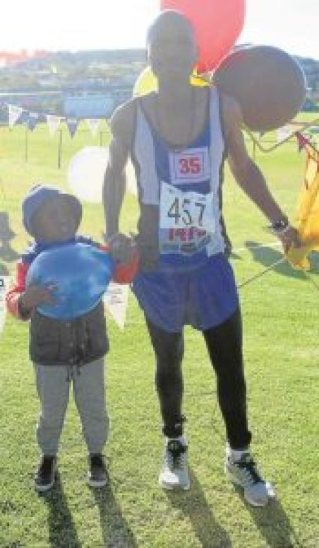 PROUD PAIR:  Mcebisi   Yose  and son, Mabufike, celebrate after  Mcebisi  won the 40th Washie 100 Miler run from Port Alfred to East London at the weekend.  Mcebisi , who on three previous occasions, came in second, kept his cool to win his first Washie Pictures: ETHIENNE ARENDS