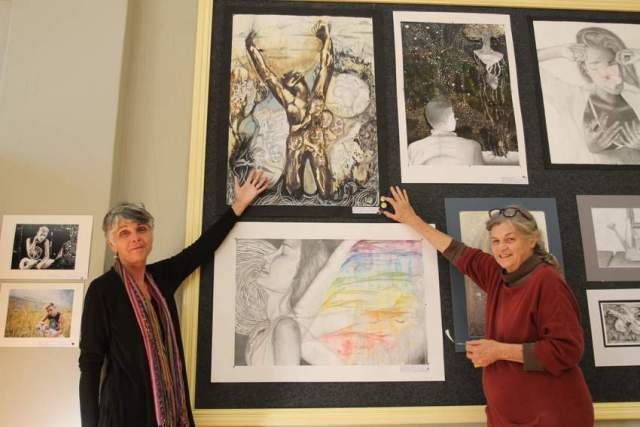REACHING NEW HEIGHTS: Stephanie Frauenstein, right, principal of the Belgravia Art Centre, gives a double gold to an artwork by Clarendon High School's Rebecca Mqamelo. EL Fest coordinator Cheryl Kent stands beside her and admires the art on display Picture: SARAH KINGON