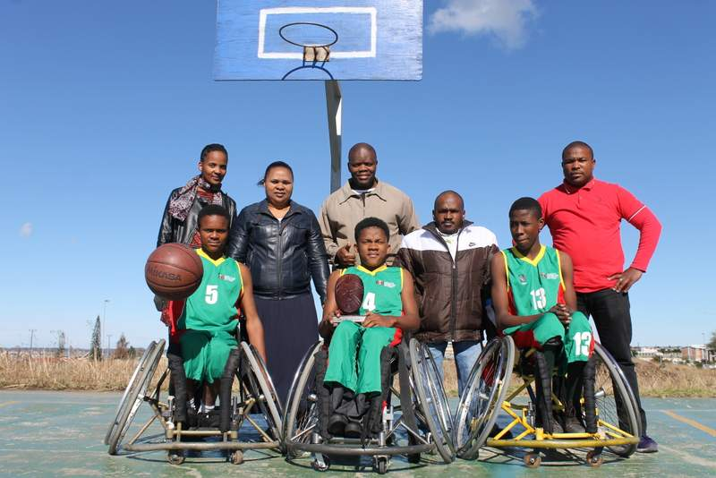 ON THE BALL: Vukuhambe pupils, from left, Yibanathi Xalisa, Mava Mlomo and Ayabonga Jim have been selected for the South African U23 wheelchair basketball team, which will represent SA at the Men's U23 World Wheelchair Basketball Championships in Toronto, Canada next year. Pictured behind are coaching staff at Vukuhambe Special School, from left, Khayakazi Magida, Zoliswa Mahlakahlaka, Xola Mambushe (head of sport at Vukuhambe ), Sonwabo Nene and Mawetu Nkungwana Picture: SARAH KINGON