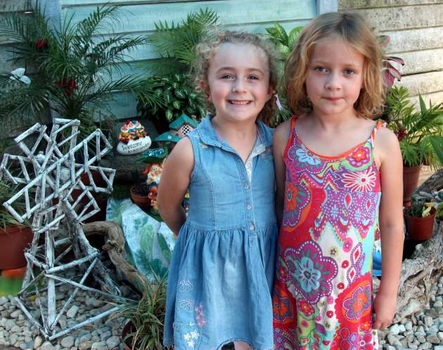 Annabel Ramsey and India-Bella Schlimper, both 6, enjoyed all the beautiful gardens in the Miniature Fairy Garden show recently Picture: ETHIENNE ARENDS