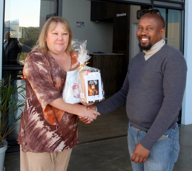 HAPPY WINNER: Xolisa Manengela (right) is the second winner of the GO! & Express and East London Coffee Company's Winter Warmers coffee competition. Congratulations to Manengela who wins the coffee hamper and goes into the draw for the grand prize of a Jura Ena 9 coffee machine valued at approximately R11000. He received his prize from Cheryl Larsen of the Go! Picture: THANDEKA NTLONTI