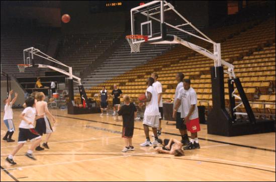 boys shooting basketball