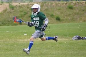 lacrosse player running across field
