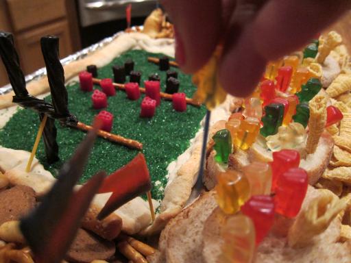 snackadium - hand placing gummy bear fan