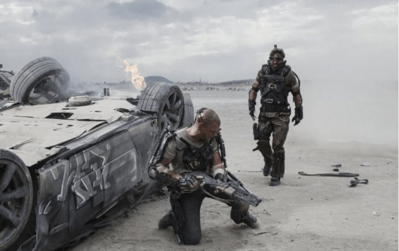 "XX (Copley) stalks an injured Max (Damon) in ""Elysium"""