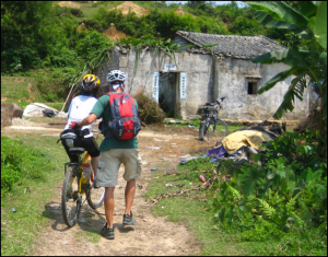 helping hands, always appreciated. bicycling in a jungle region