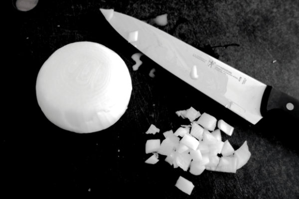 chopping a white onion onions knife