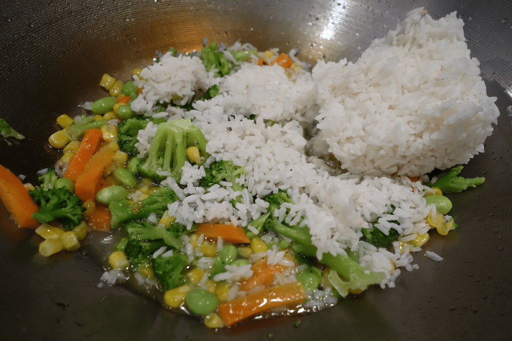 cooking fried rice - veggies and white rice