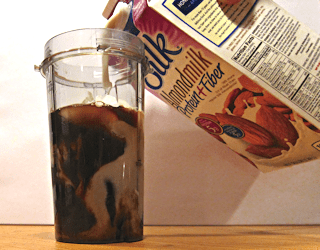 pouring silk almond milk into iced coffee for Dave's Coffee Chiller
