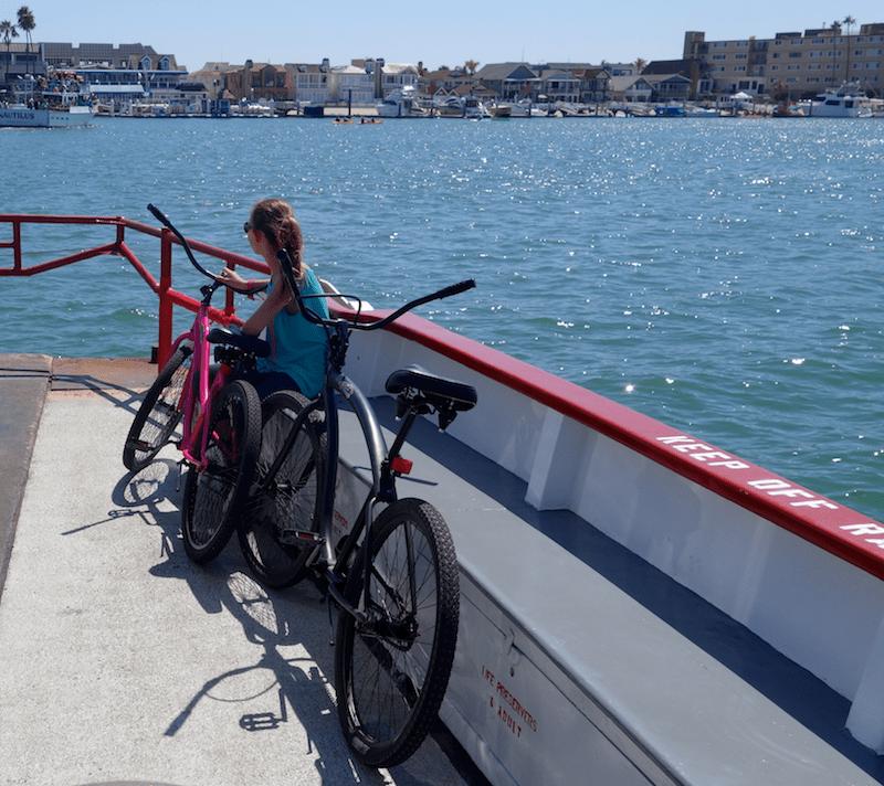 girl and bikes on balboa island ferry