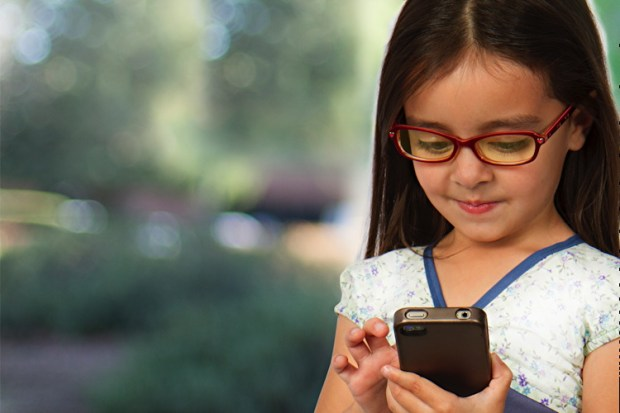 girl wearing blue light blocking unity glasses